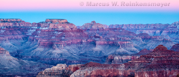 A pink afterglow appears in the eastern sky at dusk. Grand Canyon National Park in winter.  Viewed from Hopi Point.