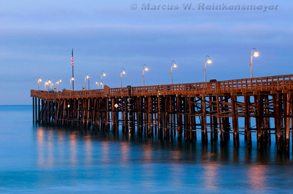 Lighted Ventura Pier reflections at dawn. Ventura, California