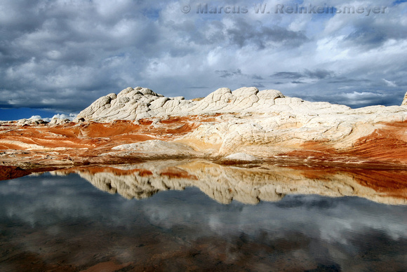 In the aftermath of heavy rains, reflections of colorful rock formations at White Pocket,  Vermilion Cliffs, Arizona.