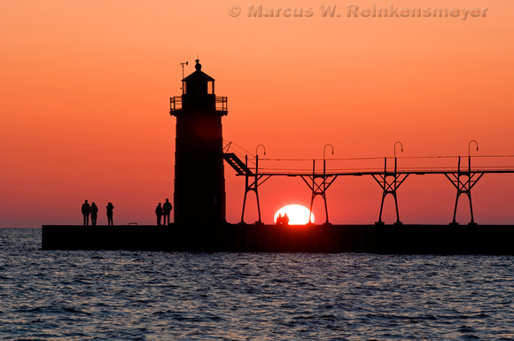 South Haven lighthouse and pier at sunset. The Great Lakes, Lake Michigan, Michigan.