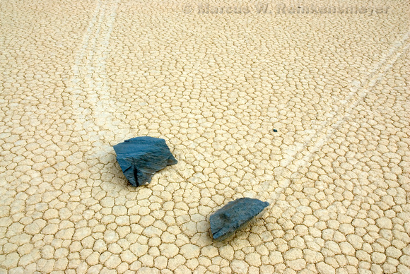 Two sliding boulders leave tracks at the Race Track, Death Valley National Park.