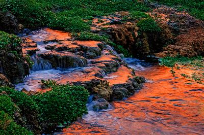Southwest landscape photography: Orange canyon wall reflections at Rock Falls (Lower Navajo Falls), Havasupai Falls, Arizona.