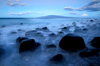 Lue misty shoreline, a time exposure image captured in the pre-dawn light at a Beach near Lahaina, Maui, Hawaii.
