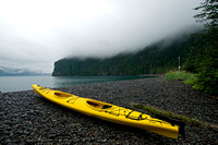 Kayak ashore on at foggy day at Fox Island, a destination location on Kenai Fjord wildlife and glacier tours, Alaska.