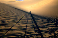 A photographer's self portrait created by long evening shadows cast on the Mesquite Flat Dunes, Death Valley National Park,  California.