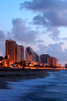 Sandy shore and hotels on the Fort Lauderdale coastline at dawn.