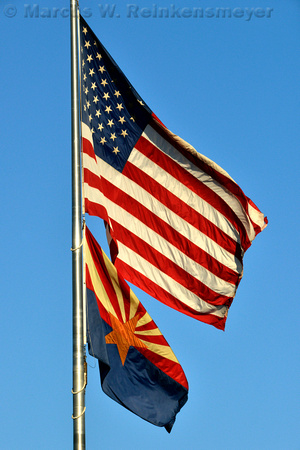 United States and Arizona State flags flying together at the Capitol Times building, Phoenix, Arizona.