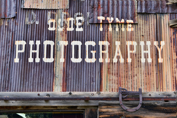Rustic signage of the Olde Tyme Photography studio in historic Silveton, Colorado.