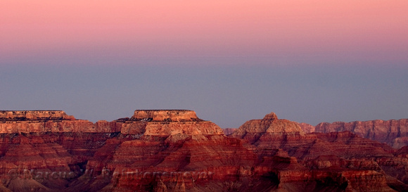 Pink afterglow at dusk. Landscape photograph at Hopi Point, Grand Canyon, Arizona.
