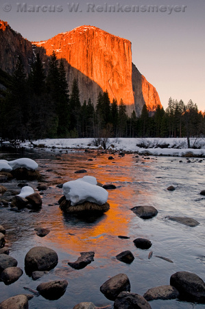 El Capitan reflection in Merced River, at sunset. Yosemite National Park.