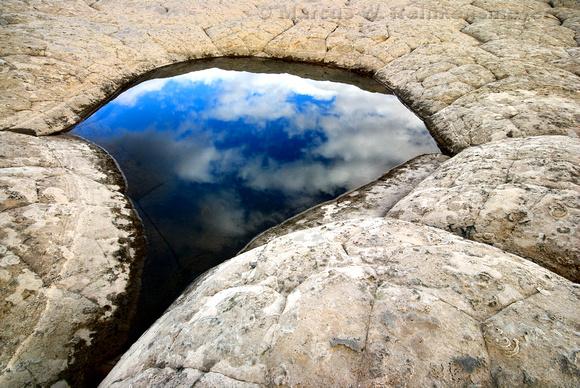 Sky reflection in transient pool at White Pocket, Paria Canyon - Vermilion Cliffs, Arizona - Utah border.