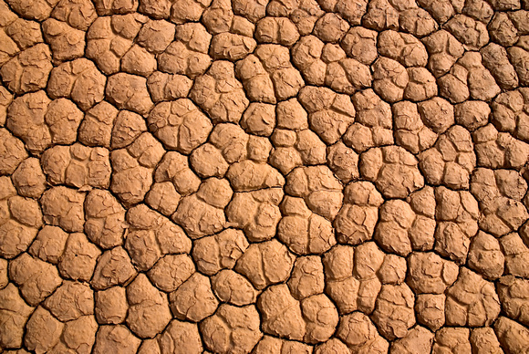 Dried playa and repeating patterns in dry lake, at the Race Track, Death Valley, California.