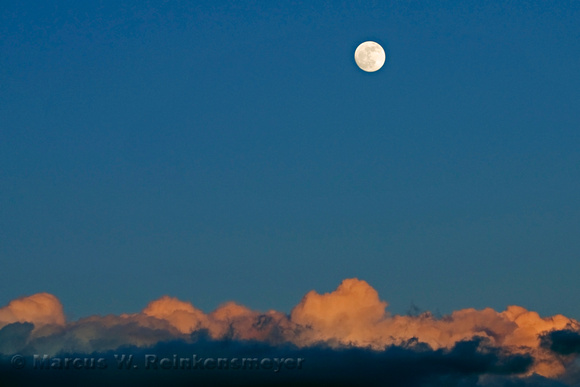 Moon rise above the clouds, at sunset. Glen Canyon National Recreation Area, Southern Utah.